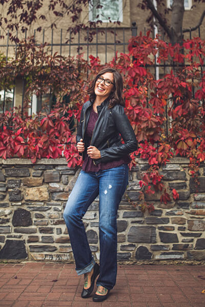 Leanne Vogel wearing jeans and a leather jacket
